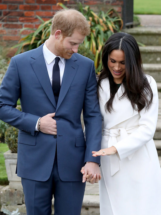 Prince Harry And Meghan Markle Pose For A Photo Call After