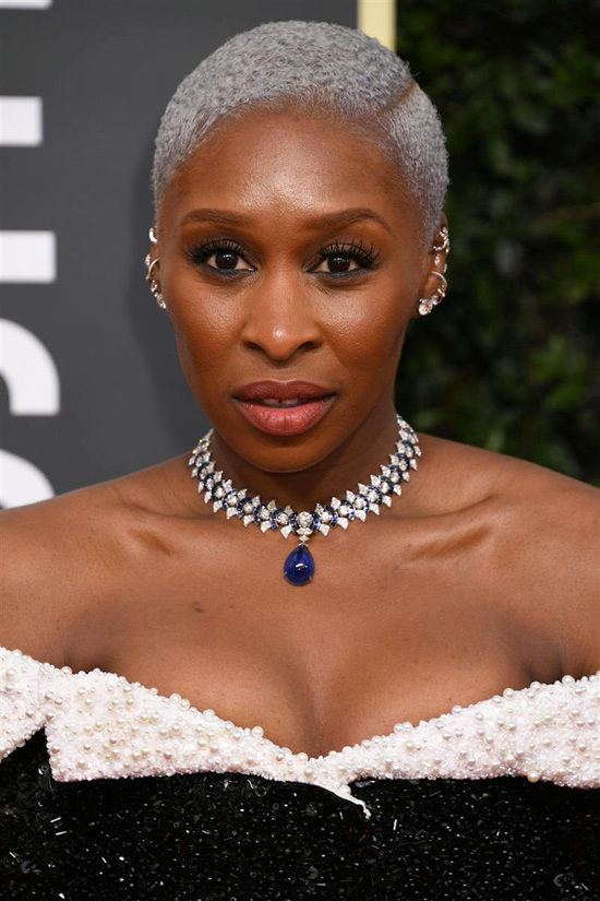 https://tomandlorenzo.com/wp-content/uploads/2020/01/Cynthia-Erivo-Golden-Globes-2020-BAFTA-Tea-Party-Red-Carpet-Fashion-Thom-Browne-Tom-Lorenzo-Site-7.jpg